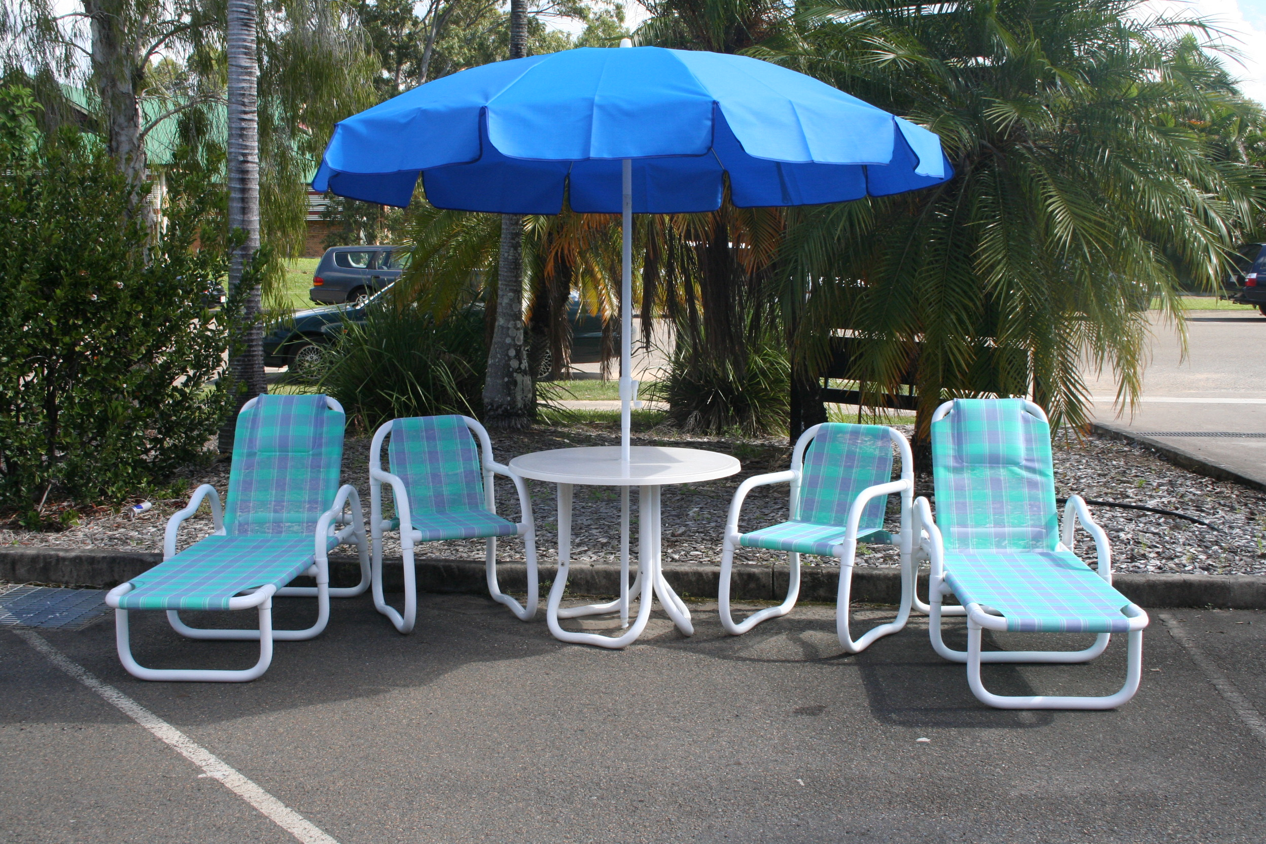PVC settting with chairs, sun lounges and umbrella